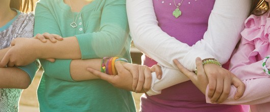 Girl Scout troop holding hands